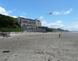 Inn-from-beach-with-kite-flyer